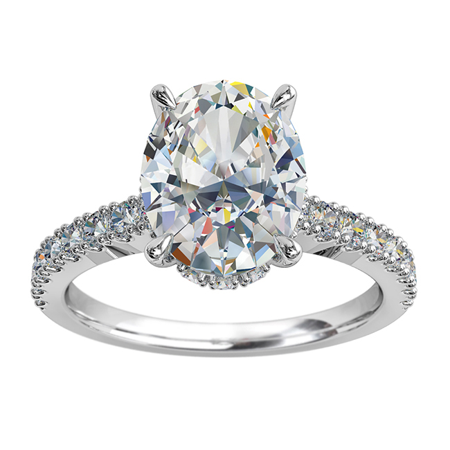 Oval Cut Solitaire Diamond Engagement Ring, 4 Claws on a Cut Claw Band, with an Invisible Halo.